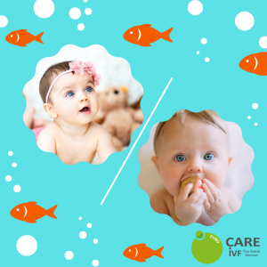 Baby with pink headband and baby playing with letter block framed by swimming fish