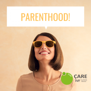 Woman in yellow sunglasses with big smile thinking about parenthood